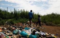 Children play at a dumpsite in Ebumnandini on the West Rand where residents leave their waste. Picture: Kayleen Morgan/EWN