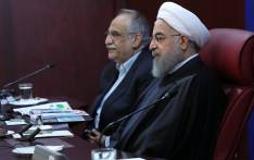 A handout picture provided by the office of Iranian President Hassan Rouhani show him (R) sitting next to Minister of Economy, Masoud Karbasian, during a meeting with members of the ministry on 8 January 2018, in Tehran. Picture: AFP.