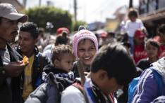 """Central American migrants traveling in the """"Migrant Via Crucis"""" caravan are pictured as they head to El Chaparral border crossing in Tijuana, Baja California state, Mexico, on April 29, 2018. At least 150 Central American migrants reached the border between Mexico and the United States on Sunday, determined to seek asylum from the US. Picture: AFP."""