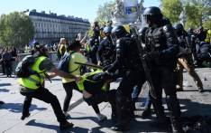 """Anti-riot police clash with protesters during an anti-government demonstration called by the """"Yellow Vests"""" (gilets jaunes) movement, on April 20, 2019 in Paris. Picture: AFP."""