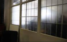 The window between what was interrogation room 1011 & 1012 at the Johannesburg Central Police Station during apartheid. Picture: Ahmed Kajee/EWN