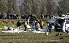 Forensic personnel carry some of the bodies at the scene of a massive blaze triggered by a leaky pipeline in Tlahuelilpan, Hidalgo state, on 19 January. 2019. Picture: AFP.