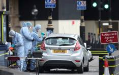 Police forensics officers work around a silver Ford Fiesta car that was driven into a barrier at the Houses of Parliament in central London on August 14, 2018. Picture: AFP.