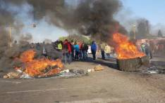 FILE: Ennerdale residents gather near burning tyres and rocks during a protest on 5 October 2018 over what they say is the neglect of coloured communities. Picture: Louise McAuliffe/EWN