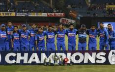 India's cricketers pose for a team photograph with the trophy after winning the third and last one day international (ODI) cricket match of a three-match series between India and Australia at the M. Chinnaswamy Stadium in Bangalore on 19 January 2020. Picture: AFP