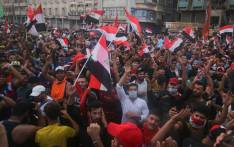 FILE: Iraqi protesters gather during an anti-government demonstration in the Iraqi capital Baghdad on 25 October 2019. Picture: AFP