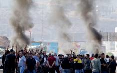 FILE: Lebanese protesters gather next to burning tyres to block the southern entrance of the capital of north Lebanon Tripoli, as anti-government demonstrations continued on 12 November 2019 across the country. Picture: AFP