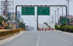 The Electronic City flyover in the technology hub of Bangalore is seen deserted during the first day of the 21-day government-imposed nationwide lockdown as a preventive measure against the spread of COVID-19, in Bangalore on 25 March 2020. Picture: AFP