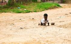 A baby crawls on the gravel in Ebumnandini, on the West Rand. The informal settlement is yet to be proclaimed as a township after 19 years. Picture: Kayleen Morgan/EWN