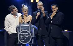 Joff Oddie, Ellie Rowsell, Theo Ellis and Joel Amey of Wolf Alice collect their award as winners of the 2018 Mercury Music prize for their album 'Visions of a Life' at the awards ceremony in central London on 20 September 2018. Picture: AFP
