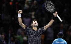 Novak Djokovic reacts after beating John Isner to claim a record-equalling sixth ATP Finals title. Picture: @ATPWorldTour/Twitter.
