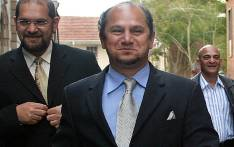 Businessman Schabir Shaik (C) leaves the Durban High court on 26 July 2005. Picture: AFP