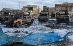 File: A picture taken with a mobile phone shows burnt vehicles at the scene of a blast by a massive car bomb, which killed dozens in a used car market in southern Baghdad. Picture: AFP
