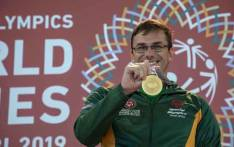 Forty-one-year-old swimmer David Coates receives his second gold medal of the Special Olympics World Games after winning the 1600m freestyle in Dubai. Picture: Thomas Holder/EWN.