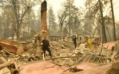 Alameda County Sheriff Coroner officers search for human remains at a burned residence in Paradise, California on 12 November, 2018. Picture: AFP