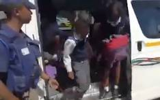A screengrab of children being taken out of an overloaded minibus taxi.