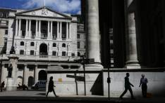 Pedestrians walk past the Bank of England (L) and the Royal Exchange in the City of London on 31 July 2017. Picture: AFP.