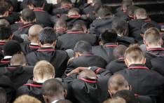 Boys from Parktown Boys' High bow their heads in memory of fellow pupil Enock Mpianzi during his memorial service at the school on 28 January 2020. Picture: Abigail Javier/EWN