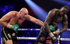 Tyson Fury (L) punches Deontay Wilder during their Heavyweight bout for Wilder's WBC and Fury's lineal heavyweight title on 22 February 2020. Picture: AFP