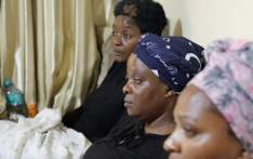 Anto Mpianzi ,the mother of Enoch Mpianzi (Middle) sit between two family members trying to emotionally process the death of her 13-year-old, son at the Nyati Bush River Lodge in Brits earlier this week. Picture: Ahmed Kajee/EWN