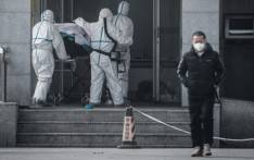 Medical staff members carry a patient into the Jinyintan hospital, where patients infected by a mysterious SARS-like virus are being treated, in Wuhan in China's central Hubei province on January 18, 2020. Picture: AFP.
