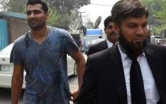 Suspended Pakistani cricketer Shahzaib Hasan (L) arrives with his lawyer at Pakistan's Federal Investigation Agency (FIA) to record his statement in Lahore on March 21, 2017