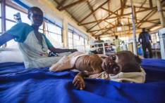 A two-month-old girl with a severe malnutrition lays on a bed next to her mother at the Aweil State Hospital, in Aweil, Northern Bahr El-Gazhal, South Sudan. Picture: AFP