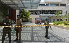 Sri Lankan security personnel stand guard at the cordoned off entrance to the luxury Shangri-La Hotel in Colombo on 21 April 2019 following an explosion. Picture: AFP.