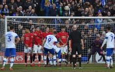 Tranmere Rovers' English striker Paul Mullin (C) hits this freekick into the crowd during the English FA Cup fourth round football match between Tranmere Rovers and Manchester United at Prenton Park in Birkenhead, north west England, on 26 January 2020. Picture: AFP.