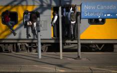 School pupils holding on an overcrowded train at New Canada train Station in Soweto, South of Johannesburg. Picture: Sethembiso Zulu/EWN