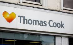 FILE: In this photo taken on 12 July 2019, a sign is pictured at a branch of a Thomas Cook travel agent's shop in London. Thomas Cook declared bankruptcy on 23 September 2019 after failing to reach a last-ditch rescue deal. Picture: AFP
