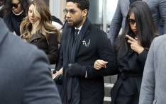 Flanked by attorneys and supporters, actor Jussie Smollett walks out of the Leighton Criminal Courthouse after pleading not guilty to a new indictment on 24 February 2020 in Chicago, Illinois. Picture: AFP