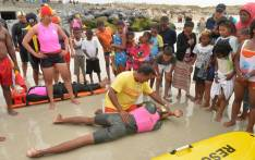FILE: Children watch a demonstration by rescue services at a Cape Town beach. Picture: Supplied.