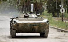 A Syrian army tank patrols an area in the district of Al-Waar in the flashpoint city of Homs. Picture: AFP
