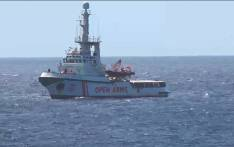 FILE: This grab from a video taken by Local Team shows Spanish humanitarian ship Open Arms arriving off the island of Lampedusa on 15 August 2019 with 147 migrants on board, after a judge in Rome suspended far-right Interior Minister Matteo Salvini's decree banning them from Italy's territorial waters. Picture: AFP.