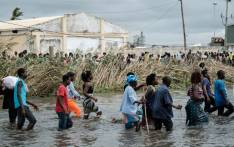 Displaced Mozambicans arrive at a warehouse for aid after Cyclone Idai hit the area, in Beira, Mozambique, on 20 March 2019. Picture: AFP
