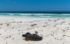 Illustration: A bottle containing a message found near Wedge Island, some 160 kilometres north of Perth. Picture: AFP.
