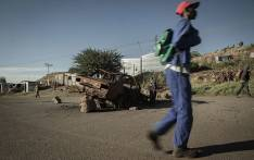 Residents of Vukaseshe, an informal settlement near Carletonville, go about their business even as operations at the nearby Sibanye-Stillwater gold mine are halted due to a 5-month long strike. Picture: Sethembiso Zulu/EWN