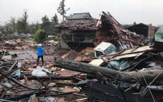 Damaged houses caused by weather patterns from Typhoon Hagibis are seen in Ichihara, Chiba prefecture on October 12, 2019. Powerful Typhoon Hagibis on October 12 claimed its first victim even before making landfall, as potentially record-breaking rains and high winds sparked evacuation orders for more than a million people. Picture: AFP