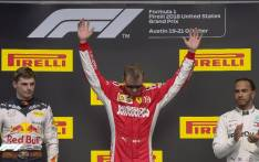 FILE: Ferrari's Kimi Raikkonen (centre) celebrates his victory at the US Grand Prix on 21 October 2018. @F1/Twitter