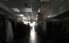 FILE: A clothing store in Claremont, Cape Town in darkness as load shedding kicks in. Picture: Kaylynn Palm/EWN