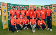 England's captain Eoin Morgan and teammates pose with the series winners' trophy after the third T20 International cricket match between South Africa and England at SuperSport Stadium in Pretoria, South Africa on 16 February 2020. Picture: AFP