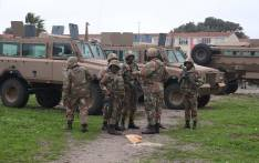 SANDF soldiers on patrol in Hanover Park. The military has released their soldiers to help stabilise gang hot-spots, while law enforcement agencies conducted raids in the area. Picture: Bertram Malgas/EWN