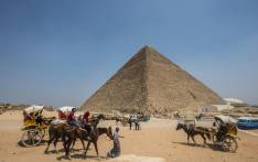 Egyptians ride their carts past the Great Pyramid of Cheops, aka Pyramid of Khufu, on 31 August 2016 on the Giza Plateau, on the southern outskirts of the capital Cairo. Picture: AFP.
