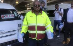 Officials from the South African National Taxi Council sanitising the hands of taxi commuters in Cape Town. Picture: Lizell Persens/EWN