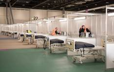 Members of the military and private contractors help to prepare the ExCel centre in London on 30 March 2020, which has been transformed into a field hospital to be known as the NHS Nightingale Hospital, to help with the novel coronavirus COVID-19 pandemic. Picture: AFP