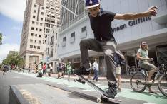 Jean-Marc Johannes hits a frontside k-grind on Bree Street during Open Streets in Cape Town. Picture: Thomas Holder/EWN