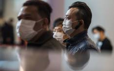 Passengers at a train station connecting Hong Kong to mainland China, wearing masks as a preventative measure following a coronavirus outbreak which began in the Chinese city of Wuhan. Picture: AFP