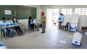 FILE: Voters being assessed before they can cast their votes at Rantailane Secondary School, in Ga-Rankuwa on 19 May, 2021. Due to COVID19 regulations and the space of the voting station, only one voter is permitted at a time. Picture: Boikhutso Ntsoko/EWN.