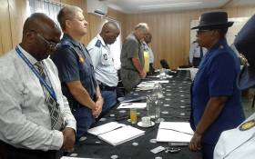 Eastern Cape police officials observe a moment of silence after five officers were killed during an attack at the Ngcobo police station on 21 February 2018. Picture:@SAPoliceService/Twitter